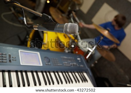 microphone near synthesizer. drummer in out of focus - stock photo