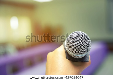 Microphone  of conference hall or seminar room background - stock photo