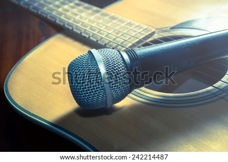 Microphone on acoustic guitar,vintage filtered. - stock photo