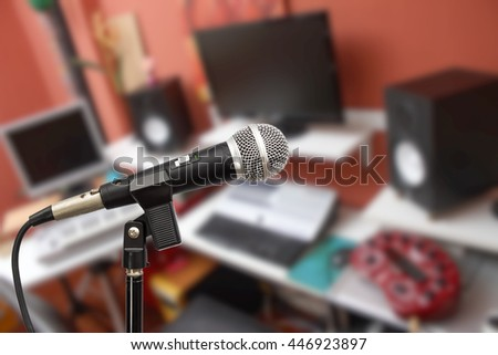 microphone on home studio recording equipment background - stock photo