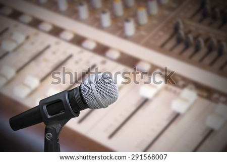 Microphone on sound mixer background - stock photo