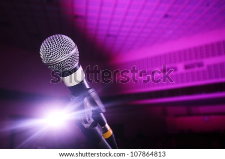 Microphone on stage. - stock photo