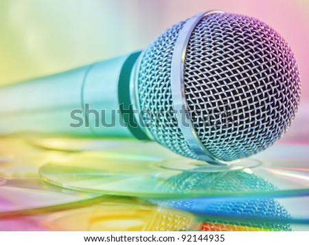 Microphone on the discs in multicolored lights - stock photo
