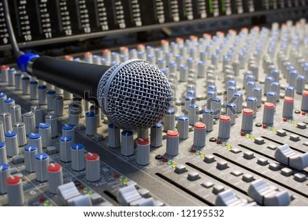 microphone on the mixing desk sound studio - stock photo