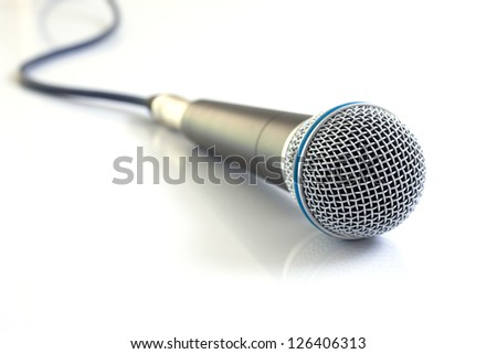 Microphone on white background. - stock photo