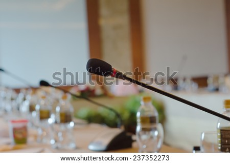 Microphone standing on a  table in the meeting room - stock photo