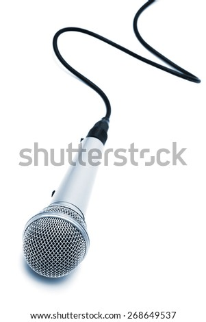 microphone with a cable on a white background - stock photo
