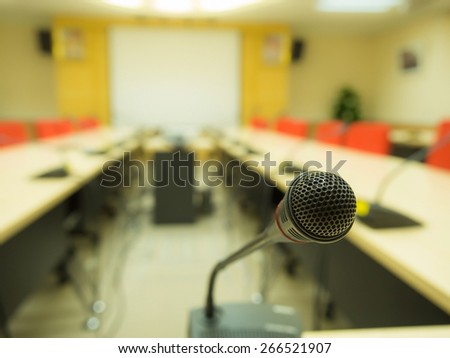 Microphone with blur conference room background. - stock photo