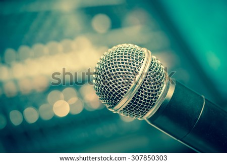 microphone with bokeh in vintage tone style - stock photo