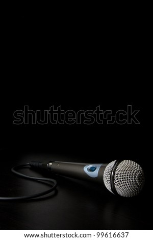 Microphone with cable isolated over a back background - stock photo