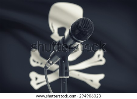Microphone with flag on background series - Jolly Roger - stock photo