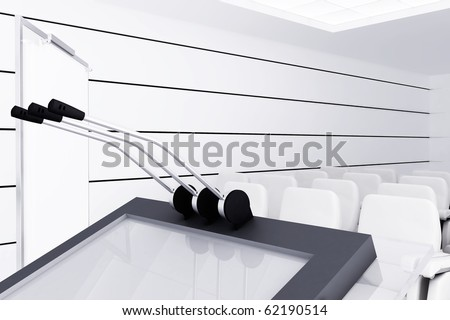 Microphones and visual board in modern conference room - stock photo