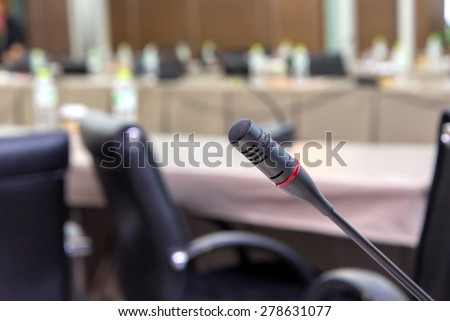 microphones in meeting room before a conference. - stock photo