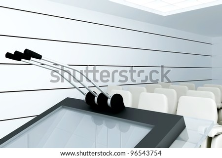 Microphones on stand  in modern conference room - stock photo