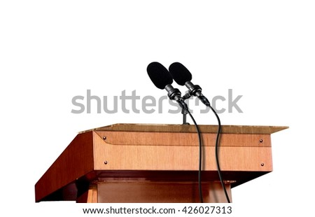 Microphones on the podium over white - stock photo