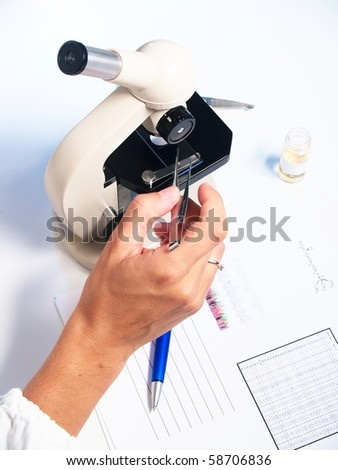 Microscope and doctor on white background - stock photo