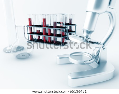Microscope and glass test tubes in laboratory - stock photo