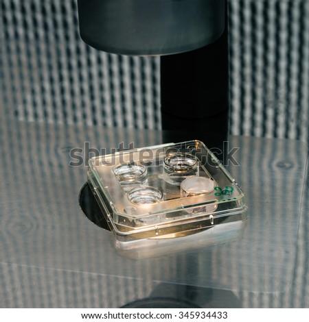 microscope for in vitro fertilization process close up.  Equipment on laboratory of Fertilization, IVF. - stock photo