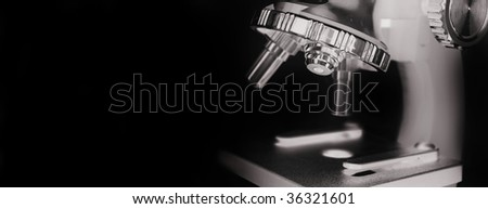microscope lens on isolated on black - stock photo
