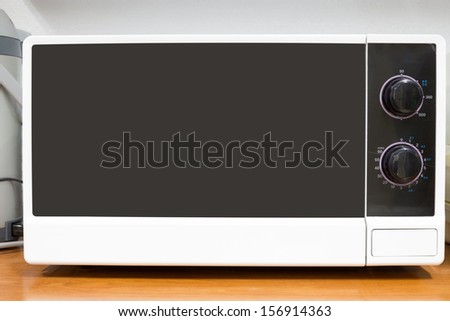 Microwave on the table - stock photo