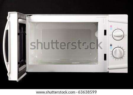 Microwave oven. On black background. - stock photo