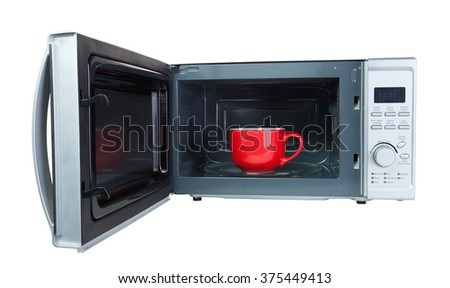 Microwave oven with a red cup. Isolated on white with a clipping - stock photo