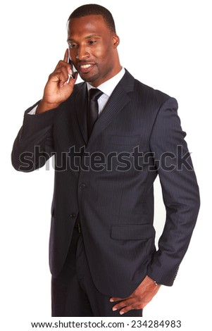 Mid adult businessman talking on mobile phone over white background - stock photo