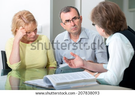 Mid adult couple  in professional marriage therapy - stock photo