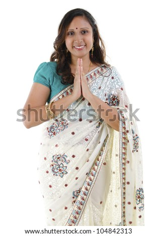 Mid Adult Indian woman in a greeting pose, isolated white background - stock photo