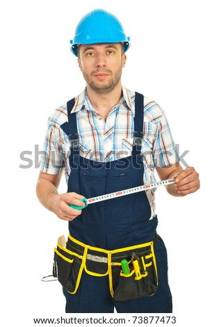 Mid adult repairman holding ruler isolated on white background - stock photo