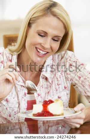 Mid Adult Woman Eating Cheesecake - stock photo