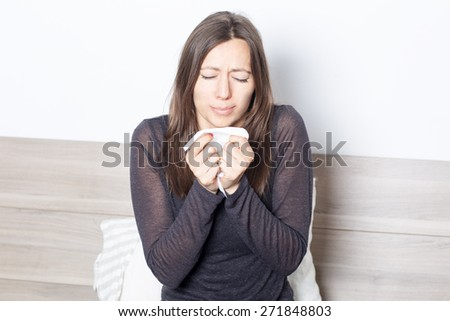 Mid-adult woman waking up with allergic reaction - stock photo