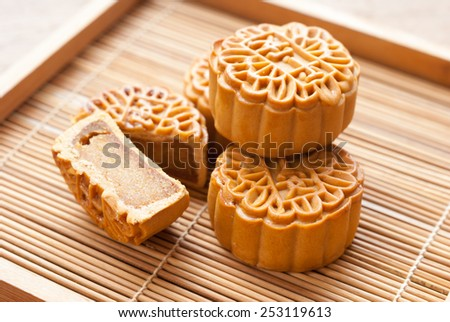 Mid-Autumn Festival moon cake on wooden board - stock photo