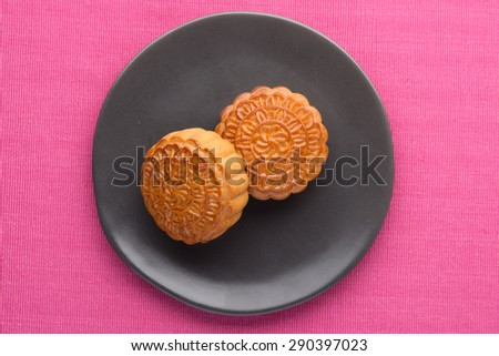 Mid-Autumn Festival moon cake on wooden board. angle view from above - stock photo
