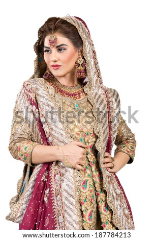 mid length shot of a beautiful muslim Indian bride - stock photo
