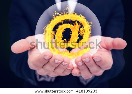 Mid section of a businessman gesturing against green background with vignette - stock photo