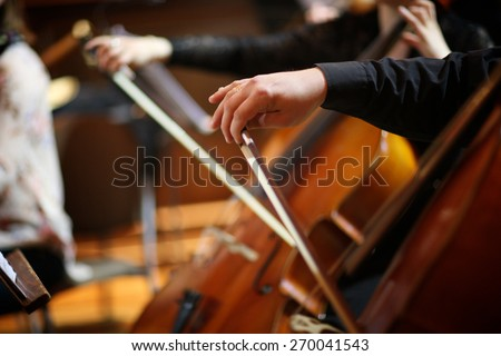 Mid section of bassists playing - stock photo
