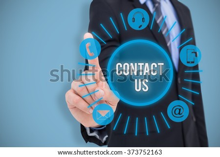 Mid section of businessman pointing something up against blue - stock photo