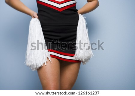 Mid section of female cheerleader - stock photo