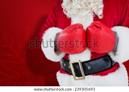 Mid section of santa with boxing gloves against red snowflake background - stock photo
