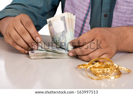 Mid section view of a man counting money - stock photo