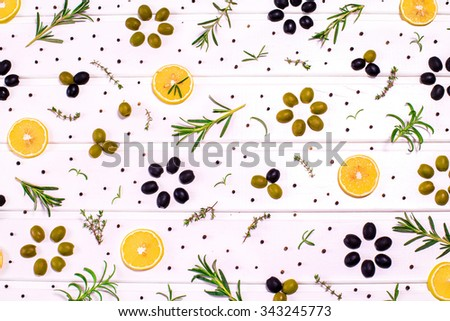 Middeterian collection of green and black olive, lemon and rosemary on the white wooden table - stock photo