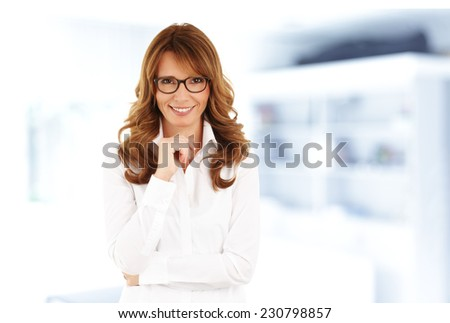 Middle age business woman standing at office.  - stock photo