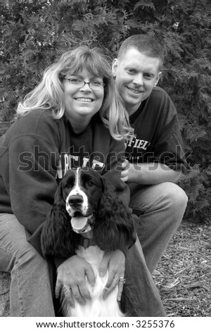 middle-age couple with their dog - stock photo