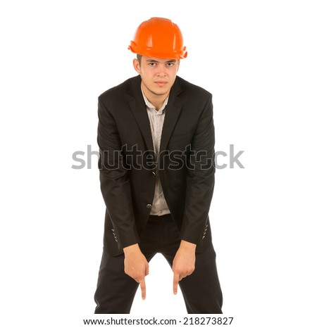Middle Age Engineer in Black Attire and Orange Helmet Looking at Camera. Isolated on White Background. - stock photo