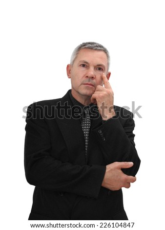 Middle age man in business black suit stands in thoughtful pose with hand on chin isolated on white background - stock photo