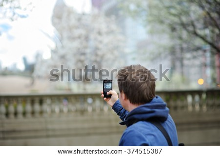 Middle age man taking mobile photo using his smart phone  - stock photo