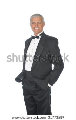 Middle Aged  Adult Male Wearing a Tuxedo with hands in pockets isolated on white - stock photo