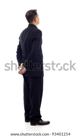 Middle aged Asian business man from the back - looking at something over a white background - stock photo