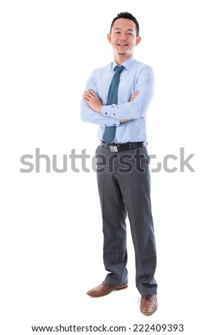 Middle aged Asian business man smiling, full length standing isolated over white background. - stock photo